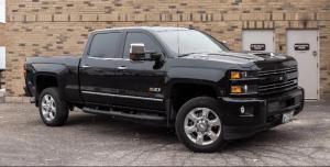 Outdoor photo of a black 2020 L5P Duramax diesel pickup truck.